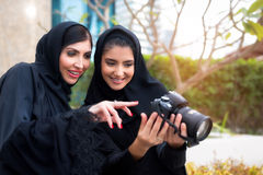 Arab Women Photography. Arab Women viewing photos on camera Stock Photography