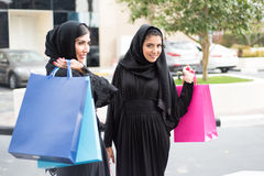 Arab Women Shopping. Happy Arab Emirati Women with Shopping Bags Outdoor Stock Photography