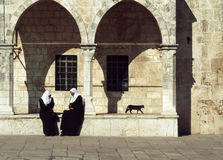 Arab women sit at the wall of the temple Royalty Free Stock Photography
