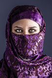 Arab women with traditional veil, eyes intense, mystical beauty Stock Image