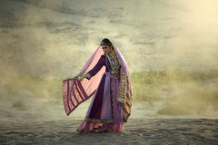 Arab women. Young beautiful  Arab woman in persia traditional dress outdoors on desert Royalty Free Stock Photos