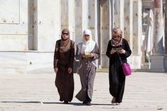 Arab women. Arab young women with traditional dress are walking at temple Mount, Jerusalem, Israel Stock Image
