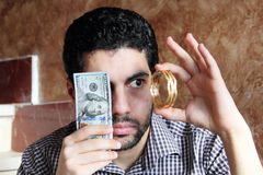 Arab young businessman with dollar bills money and gold jewelry Royalty Free Stock Photography