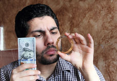 Arab young businessman with dollar bills money and gold jewelry Royalty Free Stock Images
