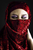 Arab young with traditional red veil, eyes intense, mystical bea Royalty Free Stock Image