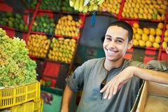 Arab youth invites to purchase fruits Stock Photos