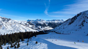 Arabba ski region view. There are many vacationers on ski resort in Dolomiti alps. This is a view to Arabba ski region Royalty Free Stock Image