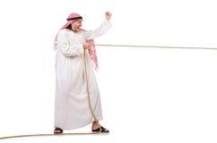 Araber im Tauziehenkonzept Stockfoto