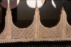 Arabesque arches reflection in the mirror of water. Alhambra of Granada Stock Photos