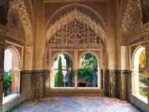 Arabesque architecture at the Alhambra in Granada Spain. Decorated room  inside Nasrid Palace in the complex of the Alhambra, Granada, Spain Stock Photos