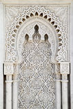 Arabesque marble panel. A beautiful Arabesque hand sculpted grey and white marble Islamic arch and panel in Rabat, Morocco Royalty Free Stock Photography