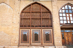 Arabesque patterns of wooden windows of old brick house in persian style Royalty Free Stock Image