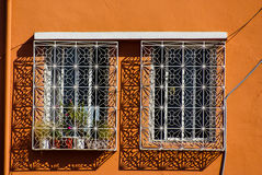Arabesque window in the medieval Kasbahi. Royalty Free Stock Images