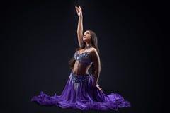 Arabia dancer posing in dark - oriental costume Royalty Free Stock Photo