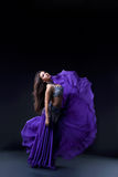 Arabia dancer posing with flying fabric Royalty Free Stock Photos