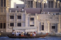 ARABIA EMIRATES DUBAI. A city boat and ferry on the Dubai creek in the old town in the city of Dubai in the Arab Emirates in the Gulf of Arabia Stock Image