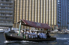 ARABIA EMIRATES DUBAI. A city boat and ferry on the Dubai creek in the old town in the city of Dubai in the Arab Emirates in the Gulf of Arabia Stock Photography