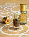 Arabian attar in a mini bottle. Concentrated oud oil perfume. Arabian attar in a mini bottle. Concentrated oud oil perfume royalty free stock photo