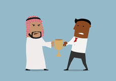 Arabian and black businessmen fighting for trophy Stock Images