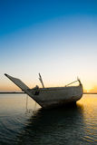 Arabian Boat. A traditional Arab fishing dhow, tied up at the quay in huwar island in Bahrain Stock Photos