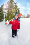 Arabian boy holds shovel and stands in winter Stock Images
