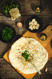 Arabian bread with herbs Stock Photo