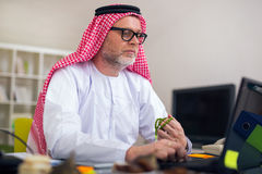Arabian business man in his home office Royalty Free Stock Photos