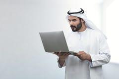 Arabian Business man looking surprised at his laptop