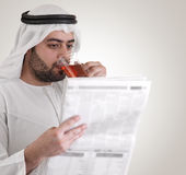 Arabian business man reading newspaper Royalty Free Stock Photo