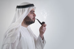 Arabian business man smoking pipe Royalty Free Stock Images