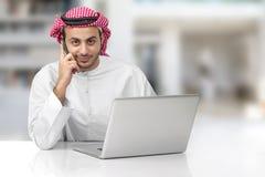 Arabian business man talking on phone in his office