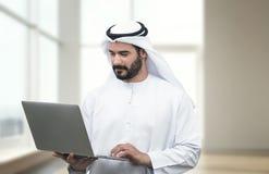 Arabian Business man using notebook in a modern office
