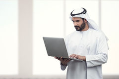 Arabian Business man using notebook in a modern office Stock Photos