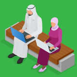 Arabian business man working on Laptop. Arab businesswoman hijab working at a laptop. Vector flat 3d isometric Royalty Free Stock Photos