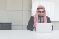 Arabian business man working on Laptop