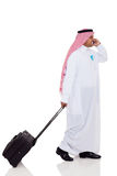 Arabian business traveler. Talking on cell phone isolated on white Royalty Free Stock Image