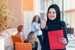 Arabian business woman with hijab holding a folder