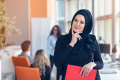 Arabian business woman with hijab holding a folder Stock Photos