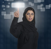 Arabian business woman pressing a touchscreen