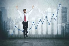 Successful Arabian businessman with growth graph Royalty Free Stock Image