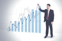 Arabian businessman drawing growth finance graph Stock Photo