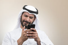 Arabian Businessman expressing disappointment on the phone Royalty Free Stock Photo
