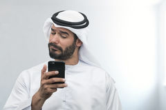 Arabian Businessman expressing disappointment on the phone Stock Photo