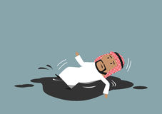 Arabian businessman falling into crude oil puddle Stock Photo