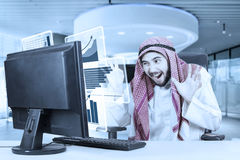 Arabian businessman feels happy with virtual graph Royalty Free Stock Photography