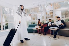 Arabian Businessman Holding A Suitcase In Office.