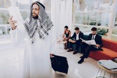 Arabian Businessman Is Holds A Tickets In Office.