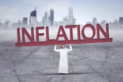 Arabian businessman with Inflation word stock photo