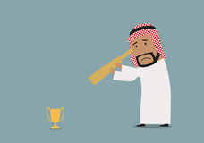 Arabian businessman looking at prize Royalty Free Stock Photography