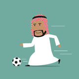 Arabian businessman running with soccer ball Royalty Free Stock Images